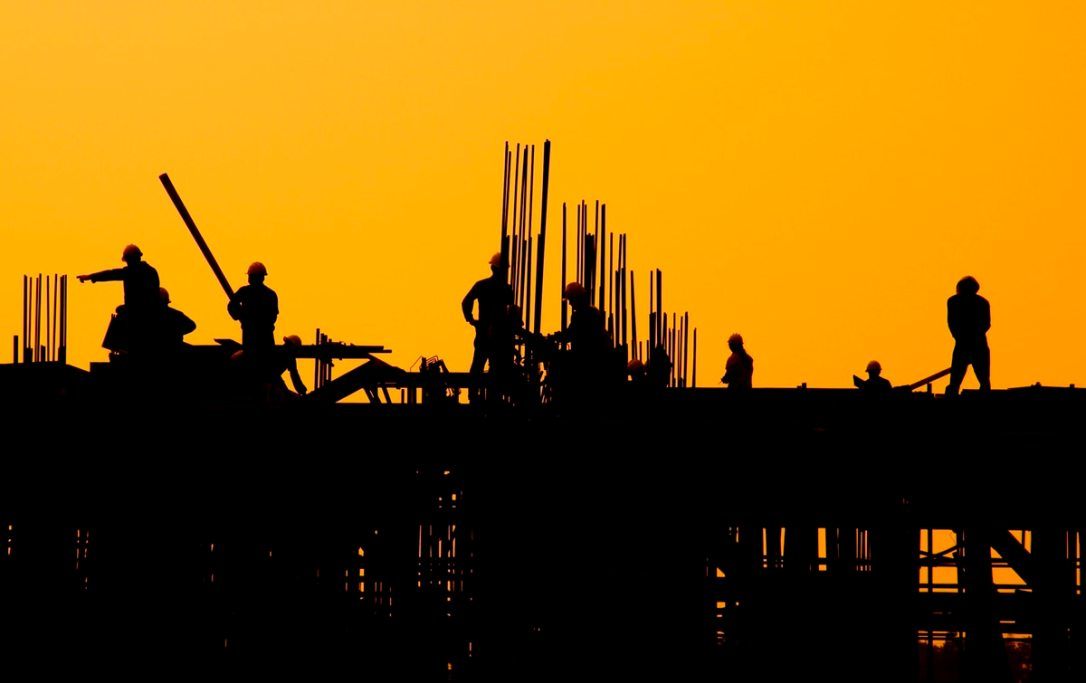 construction workers sunset